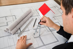 Architect Using Compass On Blueprint Royalty Free Stock Photo