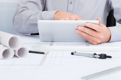 Architect using digital tablet Royalty Free Stock Photos
