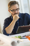 Architect Using Digital Tablet At Desk Royalty Free Stock Photos
