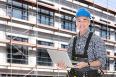 Architect using laptop against building Stock Image