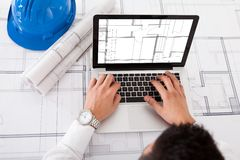 Architect using laptop in office stock photo