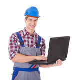 Architect Using Laptop. Portrait Of Young Male Architect Using Laptop Over White Background Royalty Free Stock Image