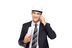 Architect using mobile phone Stock Photography