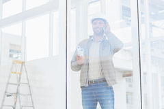 Architect using mobile phone in office Royalty Free Stock Image