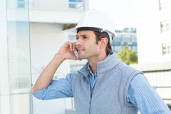 Architect using mobile phone outdoors Royalty Free Stock Photos