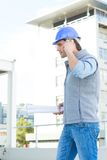 Architect using mobile phone outside building Royalty Free Stock Image
