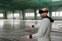 Architect with VR visor exploring industrial building environment Royalty Free Stock Image