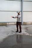 Architect with VR visor exploring industrial building environment. Empty space with room for your projection visuals or text Royalty Free Stock Photography