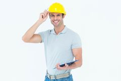 Architect wearing hard hat while holding clip board Royalty Free Stock Image