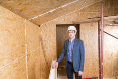 Architect Wearing Hard Hat Inside Unfinished Home Royalty Free Stock Photography