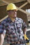 Architect Wearing Hardhat While Looking Away Royalty Free Stock Image