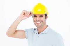 Architect wearing hardhat over white background Stock Photo
