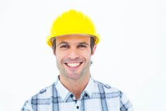 Architect wearing hardhat over white background. Portrait of happy male architect wearing hardhat over white background Royalty Free Stock Photography