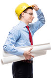 Architect wearing a helmet holding a project drawings Stock Photos