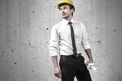 Architect wearing yellow hard hat Royalty Free Stock Photography