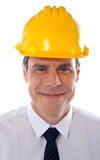 An architect wearing yellow safety helmet Stock Images