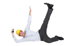 An architect in a weird pose. Stock Photo