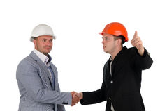 Architect welcoming a colleague and pointing Stock Photography