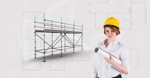 Architect woman besaide 3D scaffolding with blueprint background. Digital composite of Architect woman besaide 3D scaffolding with blueprint background Royalty Free Stock Photo