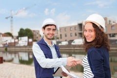 Architect woman and construction site supervisor Stock Photos