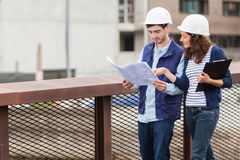 Architect woman and construction site supervisor Royalty Free Stock Images