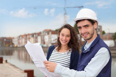 Architect woman and construction site supervisor Stock Photo
