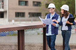 Architect woman and construction site supervisor Royalty Free Stock Photo