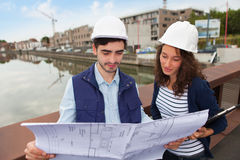 Architect woman and construction site supervisor Royalty Free Stock Photos