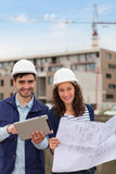 Architect woman and construction site supervisor Stock Image