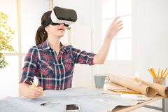 Architect woman experience VR headset. Profession and job occupation concept. asian architect woman wearing and experience VR virtual reality headset and holding Stock Image