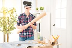 Architect woman experience VR technology. Happy beautiful asian architect woman holding paper draft experience VR virtual reality technology to simulation her Royalty Free Stock Image