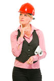 Architect woman with flip charts looking in corner Stock Photography