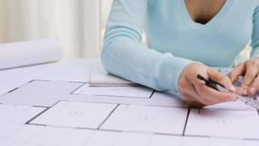 Architect woman measuring blueprint with compass stock video footage