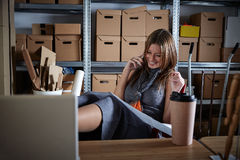 Architect woman office warehouse talking mobile Stock Images