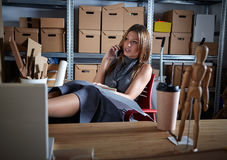 Architect woman office warehouse talking mobile Royalty Free Stock Image