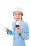 Architect woman with phone and cup Stock Photography