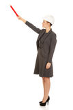 Architect woman pointing up with pencil. Stock Image