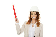 Architect woman pointing up with pencil. Royalty Free Stock Photos