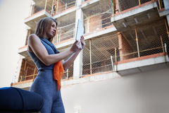 Architect woman real estate checking plan Stock Photography