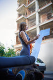 Architect woman real estate checking plan Stock Images