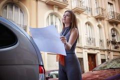 Architect woman real estate checking plan Royalty Free Stock Photos