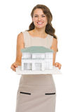Architect woman showing scale model of house Stock Photo