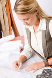 Architect woman sketches office with blueprint Royalty Free Stock Image