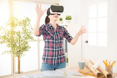Architect woman using VR to design. Profession and job occupation concept. architect woman using VR virtual reality glasses technology to design and simulation Royalty Free Stock Image
