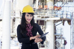 Architect woman working at construction site. Architect woman holding electronic tablet at construction site Stock Images