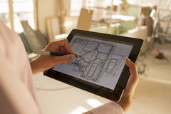 Architect woman working with electronic tablet Royalty Free Stock Images