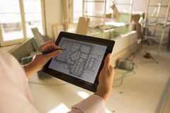 Architect woman working with electronic tablet Royalty Free Stock Photography