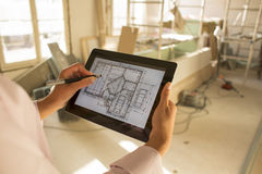 Architect woman working with electronic tablet Stock Photo