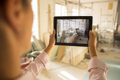 Architect woman working with electronic tablet, takes a picture Royalty Free Stock Photos