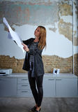 Architect woman working holding plan at office. Architect woman working holding plan paper at office Royalty Free Stock Photos